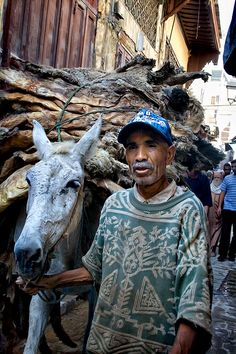 Fes, Morocco  My donkey is my truck! Donkeys are the most usual transportation way in Fez, where alleys are very narrow and there is lot of stuff to carry.  Here you can see a typical product of Fez carried by this donkey: leathers carried to be hand worked.