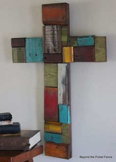Cross with colored wood pieces. This would be a neat idea if you added a scripture to each piece of wood as well.  A daily spiritual inspiration wall if you will.