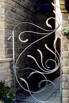 Contemporary Gates with a Design Inspired by the Sea Metal Garden Gates, Metal Gates, Wrought Iron Gates, Wrought Iron Gate Designs, Window Bars, Blacksmith Projects, Forging Metal, Grill Design, Corrugated Metal