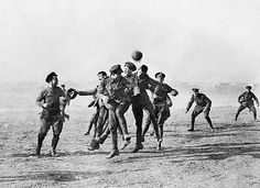 "During the Christmas Truce of 1914, German and British soldiers play a game of soccer in the ""no man's land"" between trenches"