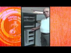 "Tony Wollenman with Visalia Safes shows a custom ""refrigerator design"" safe designed for a closet"