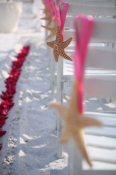 Star fish aisle makers. The perfect starfish can be ordered on line then simply add your color ribbon for quick and charming aisle markers.