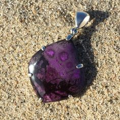 This Sugilite pendant has a beautiful hidden secret! The back of the pendant has three spiral swirls which form a loving heart. View more photos by visiting www.crystalrockstar.etsy.com  #sugilite #sugilitependant #jewelry #thirdeye #sacredgeometry #meditation #reiki #crystalhealing