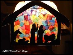 Away in a Manger Craft via Little Wonders' Daysfound a silhouette and cut it out of black construction paper for him. He placed pieces of colored tissue paper on a sheet of contact paper until it was nearly covered. Then he placed the silhouette over the paper and I helped him seal it in with another piece of contact paper.