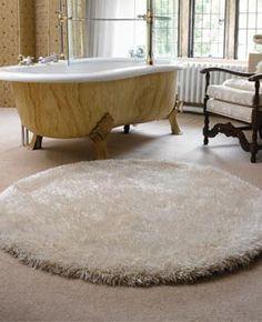 round rug and bathtub