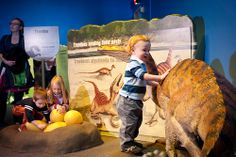 Children play with dinosaur and its eggs