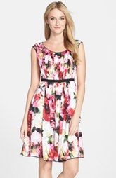 The wide neckline and cap sleeves on this Adrianna Papell Floral Print Pleated Fit & Flare Dress from Nordstrom help balance a triangle body shape. Learn how to dress your body shape and find items that work best for you while helping women in need at Styletruist.com!