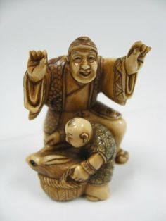 Japanese Netsuke  Man, Boy and Rabbit