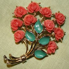 #vintage celluloid brooch, coral-pink roses and turquoise-blue leaves. $25 #SaphyreRayne on Etsy