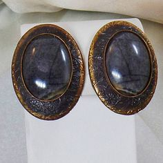 These #vintage gray tourmaline earrings are absolutely stunning!  They feature solid copper earrings with intricate engraving and a large oval gray tourmaline stone center. ... #ecochic #etsy #jewelry #jewellery