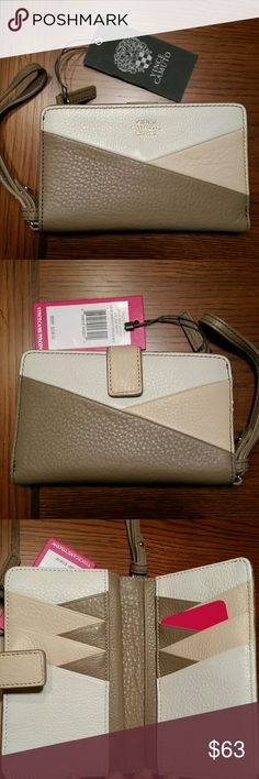 """Vince Camuto Katya Wristlet NWT Wow, this trendy genuine leather wristlet is sleek and big on Form and Function with a snap closure compartment with 10 card slots 4 slip pockets and 2 bill pockets and a zippered compartment to keep your goodies safe. Patchwork color exterior is called Milk / Silver / Almond.  5"""" wrist strap, 6"""" W x 4"""" H x 1""""D. NWT,  in original packaging. Vince Camuto Bags Clutches & Wristlets"""