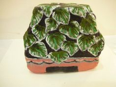 House plant even the most black thumb can't kill. Hand painted plant rock.