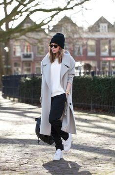 this look : White Crew-neck T-shirt — Grey Coat — Black Sweatpants — Black Beanie — Black Leather Backpack — White Athletic Shoes — Gold Watch — Black Leopard Sunglasses Looks Street Style, Looks Style, Mode Outfits, Casual Outfits, Sporty Chic Outfits, Sporty Chic Style, Trendy Style, Girl Outfits, Best Winter Coats