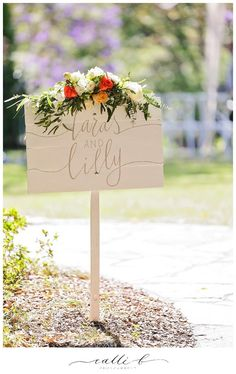 Ceremony entry sign flowers