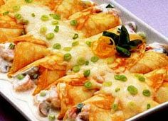 Seafood Crepes - Crepes  2/3  cup Gold Medal® all-purpose flour  1  cup milk  1  tablespoon vegetable oil  1  teaspoon sugar  1/4  teaspoon baking powder  1/4  teaspoon salt  1  egg  Filling  2  tablespoons butter or margarine  1/4  cup chopped fresh mushrooms  4  medium green onions, chopped (1/4 cup)  2/3  cup small cooked shrimp  1  package (6 oz) frozen cooked crabmeat, thawed, drained  1/2  cup half-and-half  2  packages (3 oz each) cream cheese, cubed  1  cup shredded Swiss cheese (4…