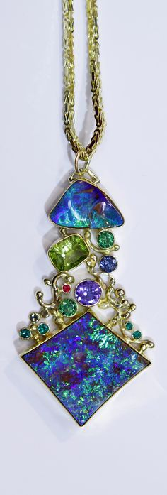 """The Heart of the Matter"" Boulder opal pendant with ruby, emerald, tsavorite, tanzanite, peridot and topaz in 22k and 18k gold. Designed by Jennifer Kalled. Boulder Opal from Bill Kasso."