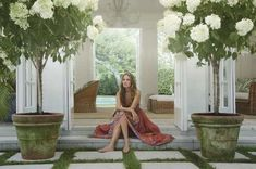 Aerin Lauder..... potted hydrangeas and square stone pavers. Love!