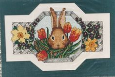 Rabbit with Tulip - (Cross Stitch) Find your next floral design at Cobweb Corner. Save 20% off your first order with coupon WELCOMECC  #crossstitch #flowers #cobwebcorner