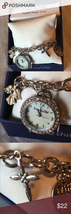 Love This Life Silver Charm Bracelet Watch Love This Life Silver Charm Bracelet Watch. Lovely watch for a special meaningful gift. Charms include angel, cross, faith pendant & watch on silver link chain bracelet. NWT in original box. Love This Life Accessories Watches