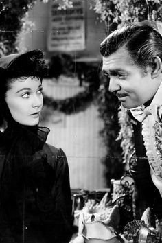 Vivien Leigh as Scarlett O'Hara and Clark Gable as Rhett Butler in the scene at the hospital bazaar in 'Gone With The Wind'.