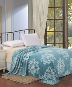 Turquoise Microplush Daisy Blanket ...   Plazatex  ...    size: size chart.. Queen $19.99  . King $21.99  . : Product Description:  This blanket features a subtle floral motif and a lovely saturated color, while airy construction adds lightweight warmth to your bed.      100% polyester  .     Machine wash  .     Imported