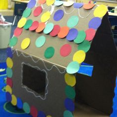Made this cute Gingerbread house out of cardboard. It has become the hottest free choice center for the kiddos.