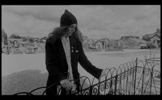Patti Smith at Arthur Rimbaud's grave in Charleville-Mezieres Cemetery.