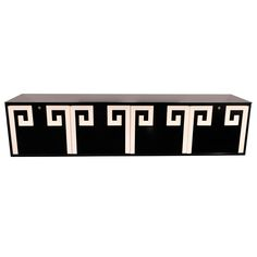 CUSTOM BLACK & WHITE GREEK KEY LACQUERED WALL-MOUNTED CREDENZA http://www.1stdibs.com/furniture/storage-case-pieces/credenzas/