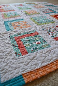 Square One Quilting Closeup by btacey, via Flickr - love the double stitch on the binding