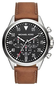 Chronograph eyes punctuate a utilitarian watch with a dashboard-inspired dial and topstitched leather strap.