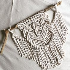 This small macrame wall-hanging is hand-made by Hanifah Tohir. Every piece is a unique product as the sticks used will vary from one to another. It will hang beautifully on  small wall or you can hang it amongst a cluster of other small artworks.  Measurement: Length approx 38cm Height approx 38cm