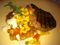 Steak Filet with rosemary potato cakes and corn salsa drizzled with chipotle sauce. yum!