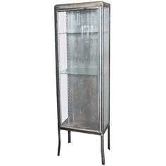 A pair of 1930s French wrought iron and glass display cabinets / vitrines | From a unique collection of antique and modern vitrines at https://www.1stdibs.com/furniture/storage-case-pieces/vitrines/