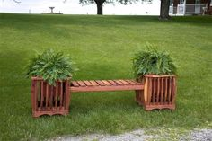 Amish Cedar Wood Planter Bench A pretty place to sit with built in planters on each end! Solid cedar wood with rich red tones. Handcrafted in Amish country.