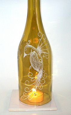 Etched wine glass luminary -  I like the general idea but not completely sold on the bird