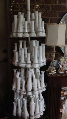 Milk glass vases. ♥ I like how many there are! Mine sit on top of a corner cupboard. Wish I had this many!
