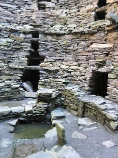 "Mousa, Shetland, Scotland. The inner walls of this Iron Age broch are still to be seen 1400 years after this exchange with Gwen: ""They're much taller and airier than these,"" he announced, gesturing toward our low houses and small doorways. ""Most of the rooms facing the courtyard are open, with hide curtains you can pull back so you can look down into the court, or up to the sky. My quarters at Midhowe are on the top tier, and it's like sleeping in a nest."""