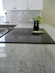 Kashmir White Granite Counters, Hampton Carrara Marble Backsplash