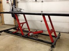 Motorcycle Lift Table by Fishman -- Homemade motorcycle lift table fabricated from steel and powered by a pneumatic cylinder. Caster-mounted for enhanced mobility. http://www.homemadetools.net/homemade-motorcycle-lift-table-5