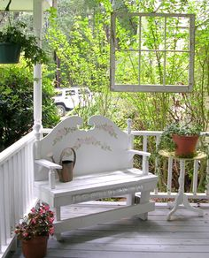 Front porch shabby chic with an old window hung over bench for atmosphere...