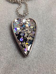 Holographic glitter resin heart pendant on Etsy, $17.00