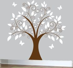 love the white leaves on grey background behind tree