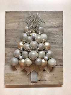 Rustic glam Christmas ornament tree Approximately Shatterproof ornaments mounted on reclaimed weathered shiplap Ornaments are champagne gold and silver Classy Christmas, Christmas Holidays, Christmas Wreaths, Christmas Villages, Victorian Christmas, Christmas Christmas, Vintage Christmas, Rose Gold Christmas Decorations, Xmas Decorations