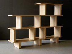 Low divider. Shelves with varying sizes, and varying height. good idea    http://office-turn.com/wp-content/uploads/2011/12/Contemporary-Room-Divider-and-Bookcase-Design.jpg
