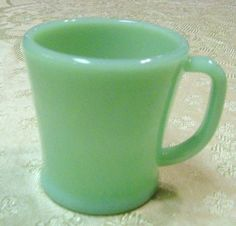 Remember drinking out of a cup like this as far back as every morning in first grade at age 5! Jadite D Handle Coffee Cup
