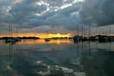 Sunset over the harbor. Photo by Margaret Feno