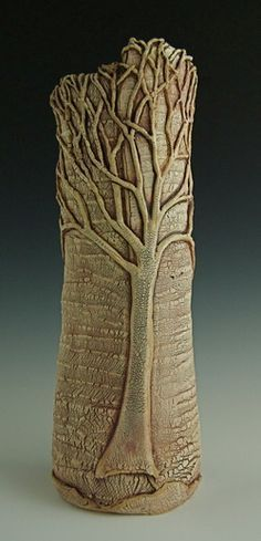 The surface texture of this vase was hand formed with a porcelain slip, which under stress creates a unique crackle effect that reveals the rich clay below. Each tree is hand sculpted, attached, undercut and treated with an iron oxide wash to create shadow and depth.