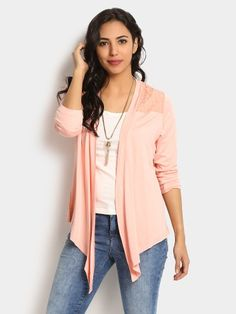 Wear this shrug over a basic white T-shirt and match it with a pair of blue denims. Slip into your favorite pair of wedges and carry a sling bag while heading out.