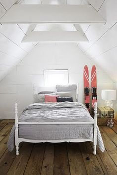 Attic remodel. Window over bed. Simple with wood floors