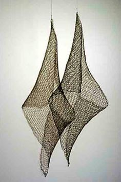 """Pas Deux Rotating Installation, Hand knit coated wire 45""""'h. 15""""w. 11""""d. KatharineCobey. Sculptural knitting."""